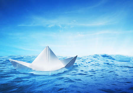paper boat on a beautiful and vibrant sea Stock Photo