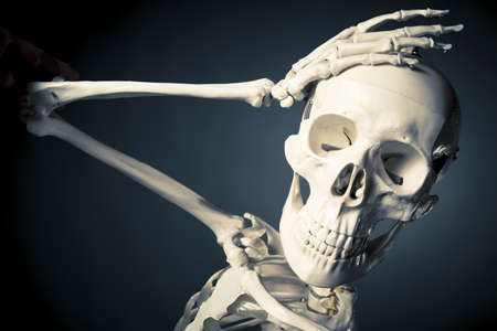 disquieted: medical skeleton model with dramatic light Stock Photo