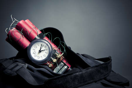 terrorists: timebomb in a backpack representing terrorist attack