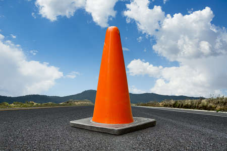 traffic cone on a road, copy space photo