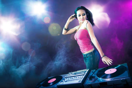 Beautiful DJ girl with bright lights photo
