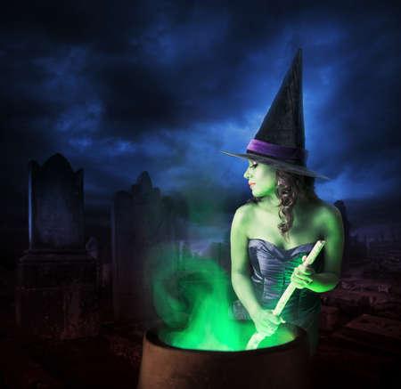 cauldron: Sexy witch on a dark background
