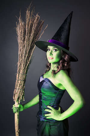 Sexy witch on a grey background