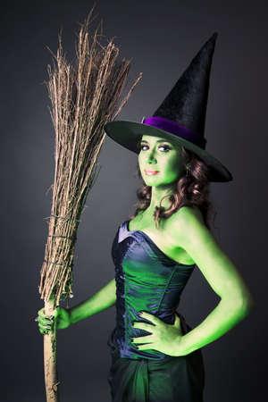 wicked: Sexy witch on a grey background
