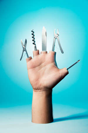 Open hand with tools on a blue background photo
