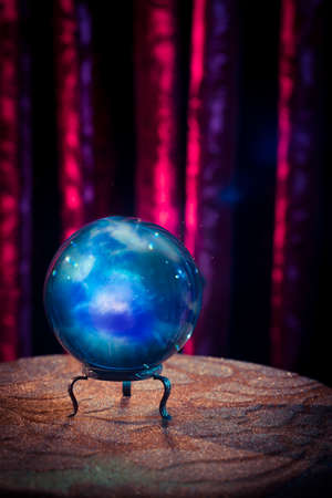 Magic crystal ball on a table photo