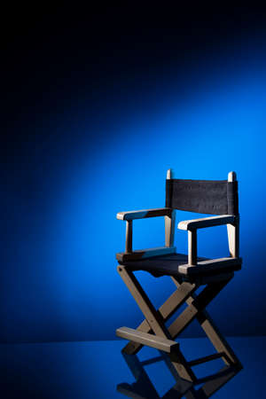 Dramatic lit Directors Chair photo