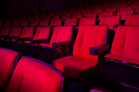 hollywood movie: Empty rows of red theater or movie seats Stock Photo