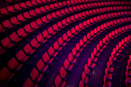 red chair: Empty rows of red theater or movie seats Stock Photo