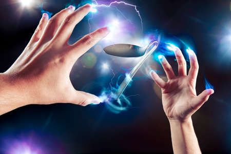 spoon bending, psychokinesis, power of the mind Stock Photo