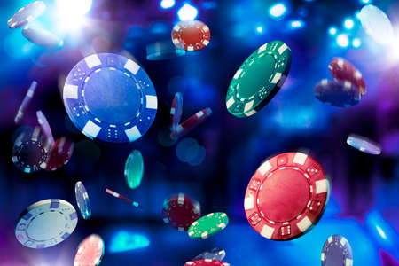 casinos: Poker Chips falling with dramatic lighting