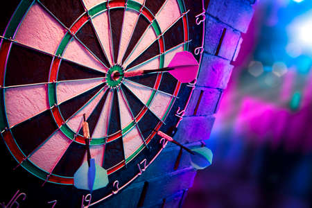 dartboard on a brick wall photo