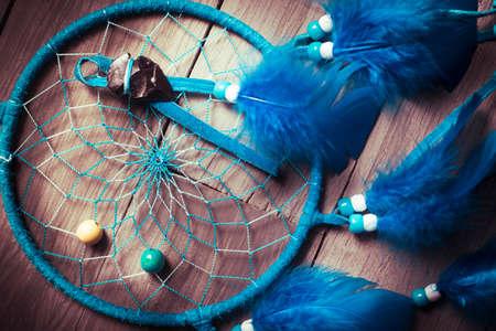 Dreamcatcher on a wood floor photo