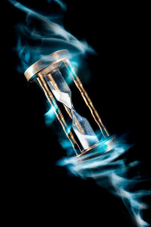 the ancient pass: dramatic lit image of hourglass, time concept Stock Photo