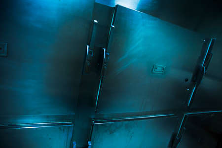 mortuary: Grungy and high contrast photo of morgue trays