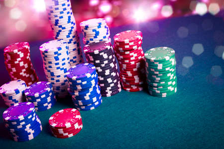 casino chips: Poker Chips on a gaming table