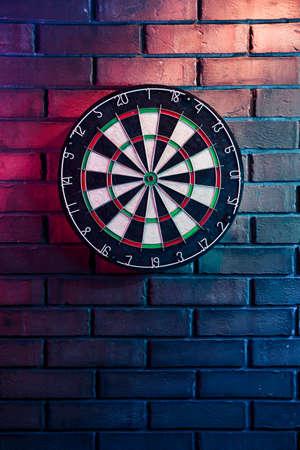 dart board: dartboard on a brick wall Stock Photo
