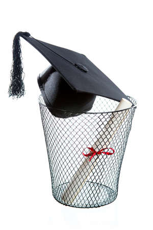 drop out: Diploma, Graduation hat inside a trashcan isolated on white