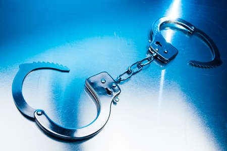 Open handcuffs, liberty concept on a metallic background photo