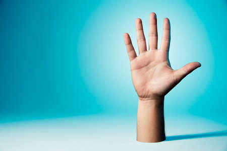 Open hand with blue background