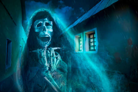 creepy Halloween background of Ghost at night