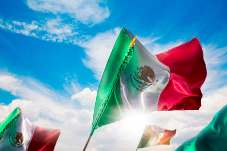 Mexican Flags with dramatic lighting, Independence day, cinco de mayo celebration photo