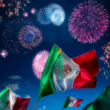 Mexican Flags with dramatic lighting, Independence day, cinco de mayo celebration Stock Photo