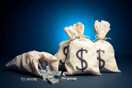 million: lots of money inside bags Stock Photo