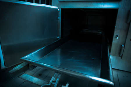morgue: Grungy and high contrast photo of morgue trays