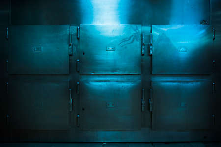 horror: Grungy and high contrast photo of morgue trays