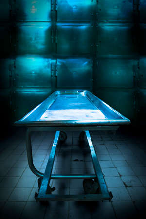 life and death: Grungy and high contrast photo of morgue trays