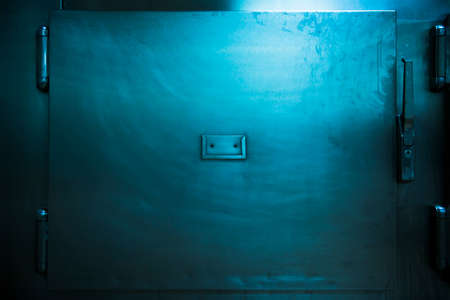 autopsy: Grungy and high contrast photo of morgue trays