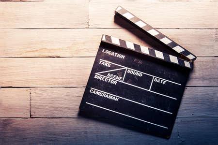 battant: photo vintage de clapet de film sur le bois