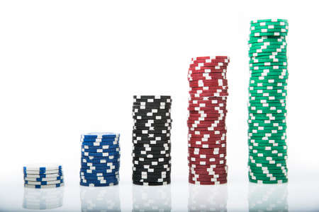 Poker Chips on white background photo