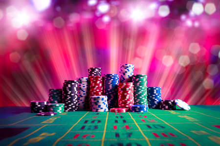 Poker Chips on a gaming table with dramatic lighting photo