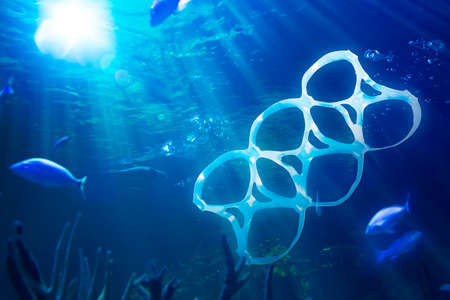 sea polluted with plastic garbage photo