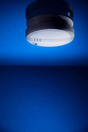 smoke detector on a blue background photo