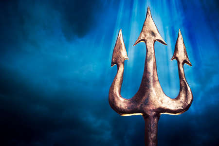 ancient atlantis: Poseidons trident on a dark sky background Stock Photo