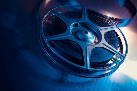 film camera: Movie reel on a metalic background Stock Photo