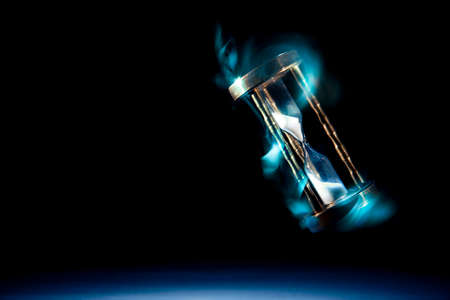 dramatic lit image of hourglass, time concept Stock Photo