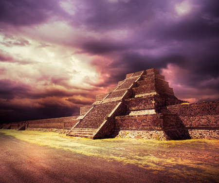 Aztec pyramid at sunset with dramatic sky 스톡 콘텐츠
