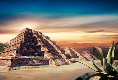 Aztec pyramid at sunset with dramatic sky photo