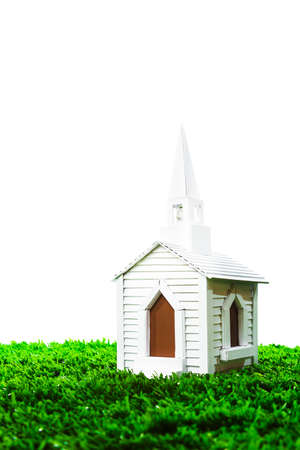isolated white chapel on grass photo
