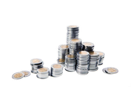 pile of coins: Stacks of mexican pesos isolated on white