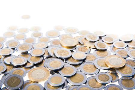 pile of coins: Mexican pesos isolated on white