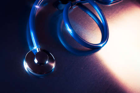 metalic: Medical Stethoscope on a metalic background and dramatic lighting