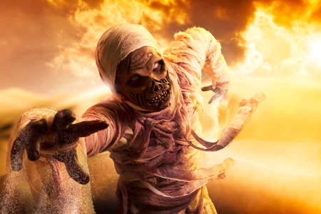 Scary Halloween mummy in hot desert with dramatic lighting photo