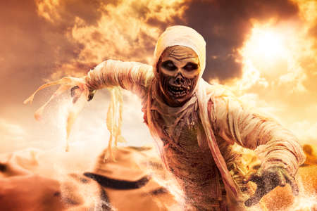 Scary Halloween mummy in hot desert with dramatic lighting