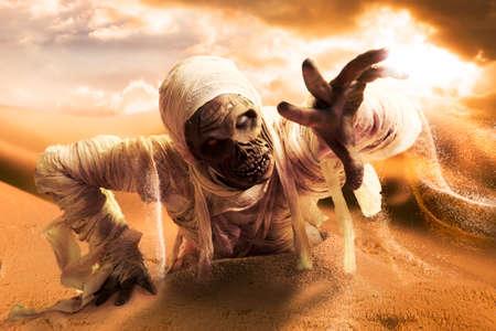 mummified: Scary Halloween mummy in hot desert with dramatic lighting