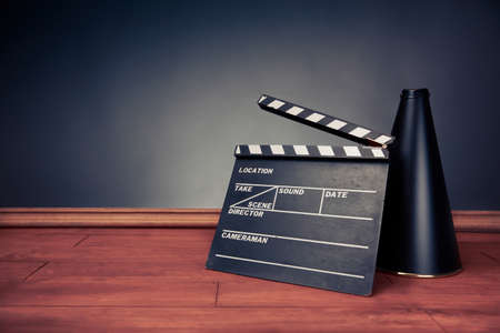 black empty board: movie industry objects on a grey background